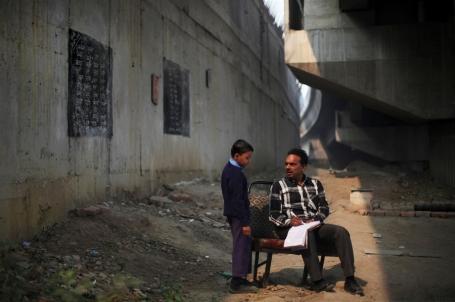 13 free schoolfor slum children uder metro bridge Dehli