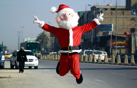 A man dressed in a Santa Claus outfit performs in the Shiite holy city of Najaf on December 17, 2015. AFP PHOTO / HAIDAR HAMDANI / AFP / HAIDAR HAMDANI (Photo credit should read HAIDAR HAMDANI/AFP/Getty Images)