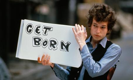 Bob Dylan with Get Born sign