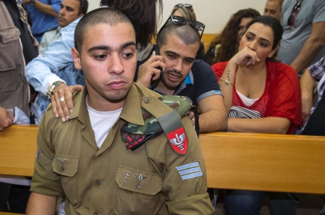 Israeli soldier Elor Azaria, who was caught on video shooting a wounded Palestinian assailant in the head as he lay on the ground, sits during a hearing at a military appeals court in Tel Aviv during which he was charged with manslaughter on April 18, 2016. Prosecutors presented the indictment to a military court over the March 24 killing, which occurred minutes after the Palestinian had stabbed another soldier and lay prone on the ground wounded by gunfire, according to Israeli authorities. He was also charged with conduct unbecoming of his rank and position in the army. / AFP / JACK GUEZ (Photo credit should read JACK GUEZ/AFP/Getty Images)